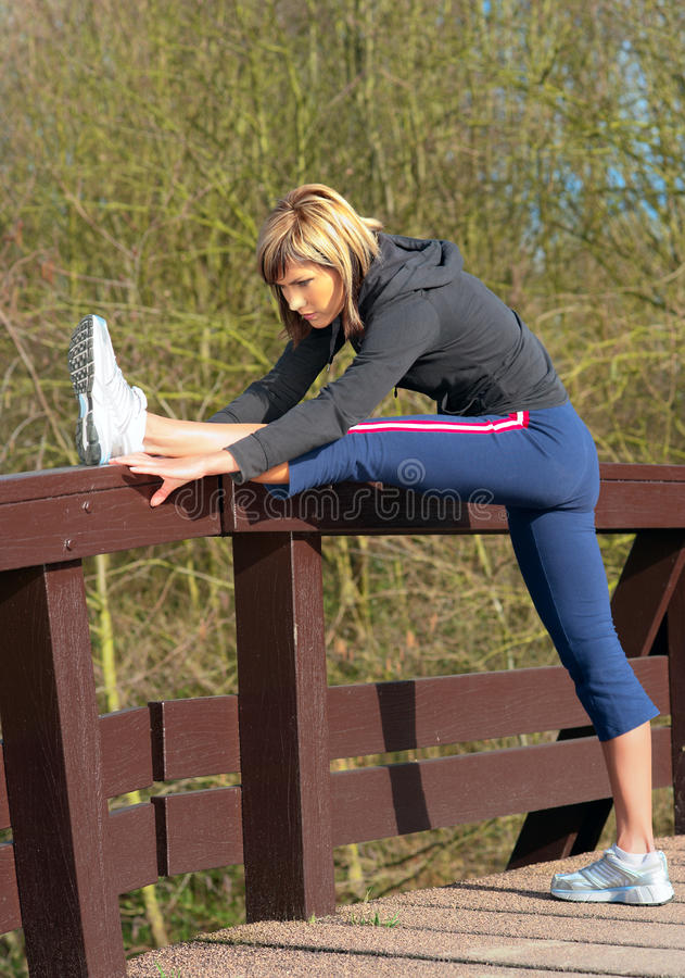Sportswoman Stretching Outdoors.