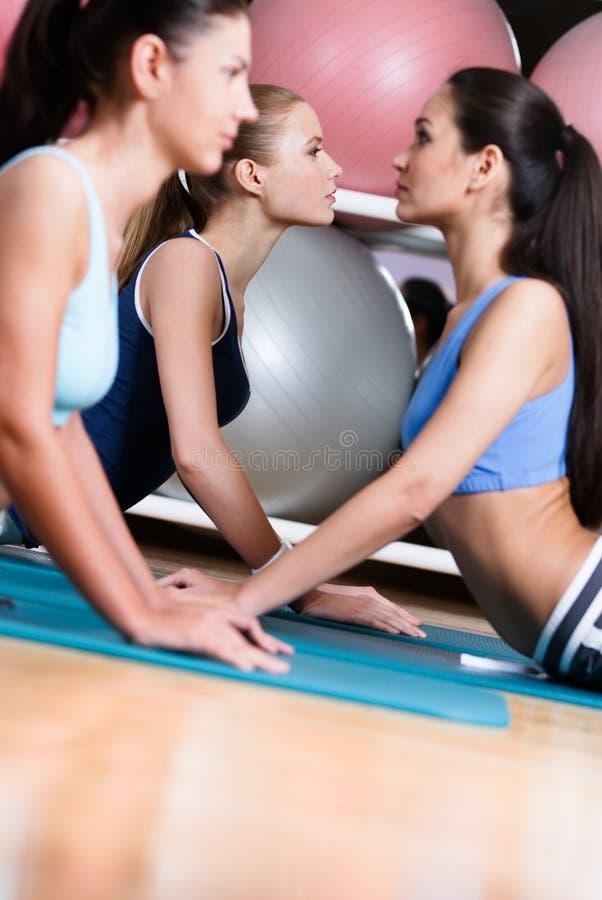 Sportswomen Doing Stretching Fitness Exercise Stock Image