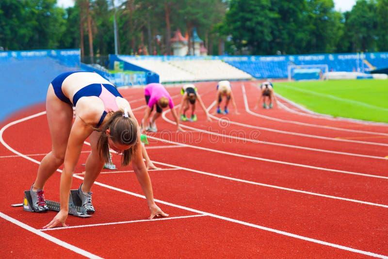 Sportswomen at the start royalty free stock image