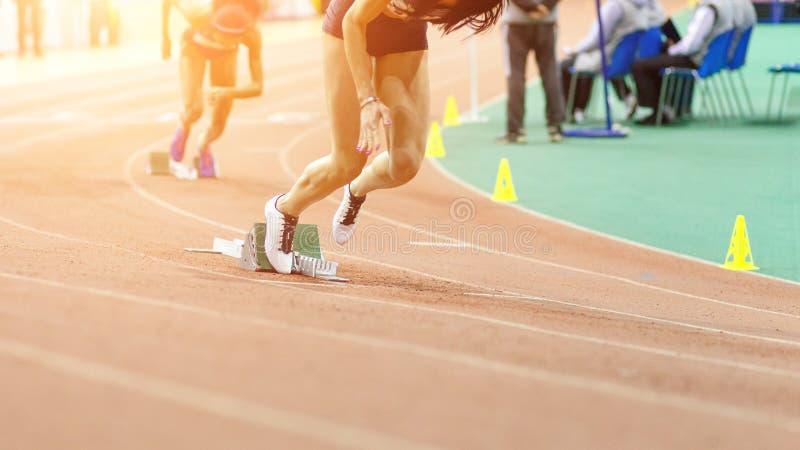 Sportswomen starting running sprint. From starting blocks stock photos