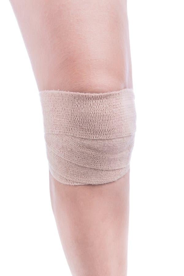 Sportverletzungen des Knies Verbandgummiband gebunden stockfotos