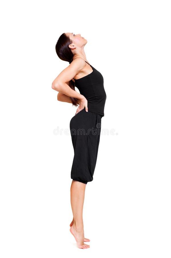 Sportvrouw die rekoefening doet stock foto
