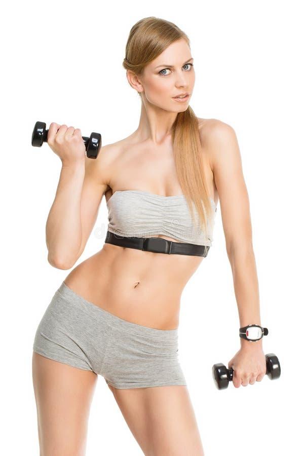 Sporty девушка с гантелями стоковое изображение