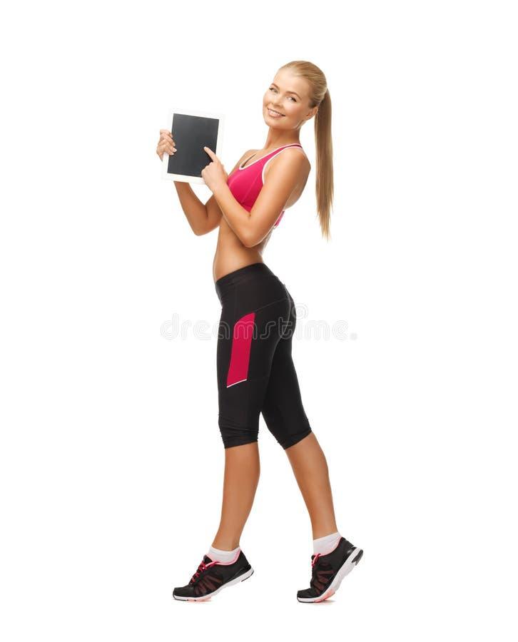 Sporty женщина с ПК таблетки стоковое фото rf