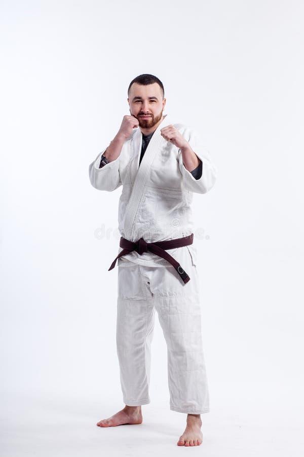 Sporty человек в кимоно стоковое фото rf