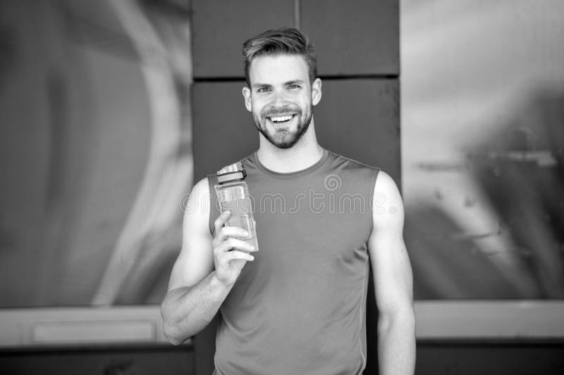 Sporty accessory. Man athlete hold special sporty bottle care hydration body after workout. Refreshing vitamin drink. Athlete drink water after training. Man stock photos