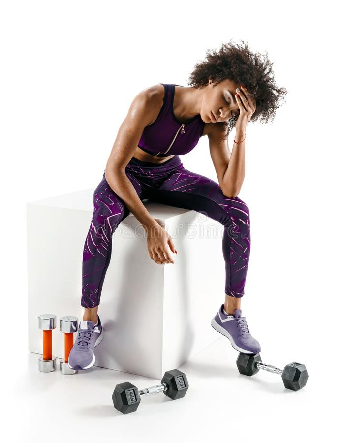 Sporty african girl is tired after intense workout royalty free stock images