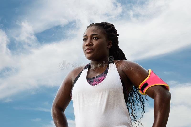 Sporty african woman  sweating after exercising on summer day. royalty free stock photography