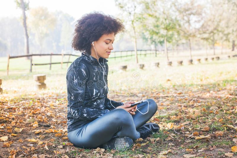 Sporty Afro Woman Enjoy Listening Music After Running stock images