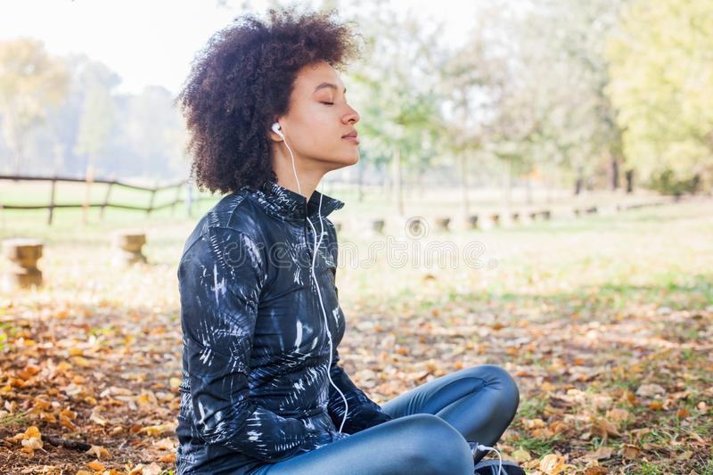 Sporty Afro Woman Enjoy Listening Music After Running stock photo