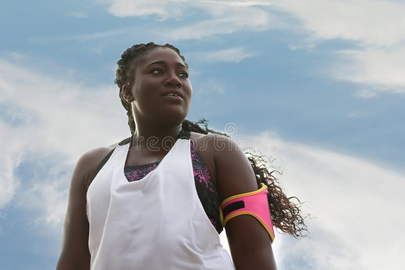 Sporty attractive african woman looking far royalty free stock photos
