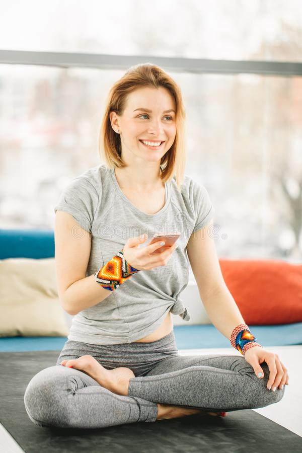 Sporty attractive woman sitting in Lotus pose stock images