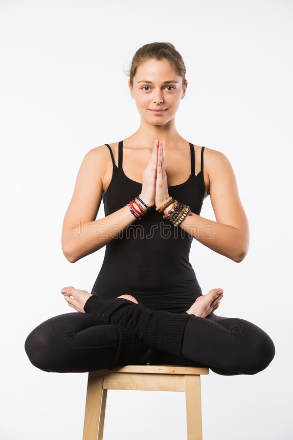 Sporty beautiful young woman sitting in Gomukhasana, Cowface pose, yin yoga Shoelace posture, asana for stretching hips stock photography