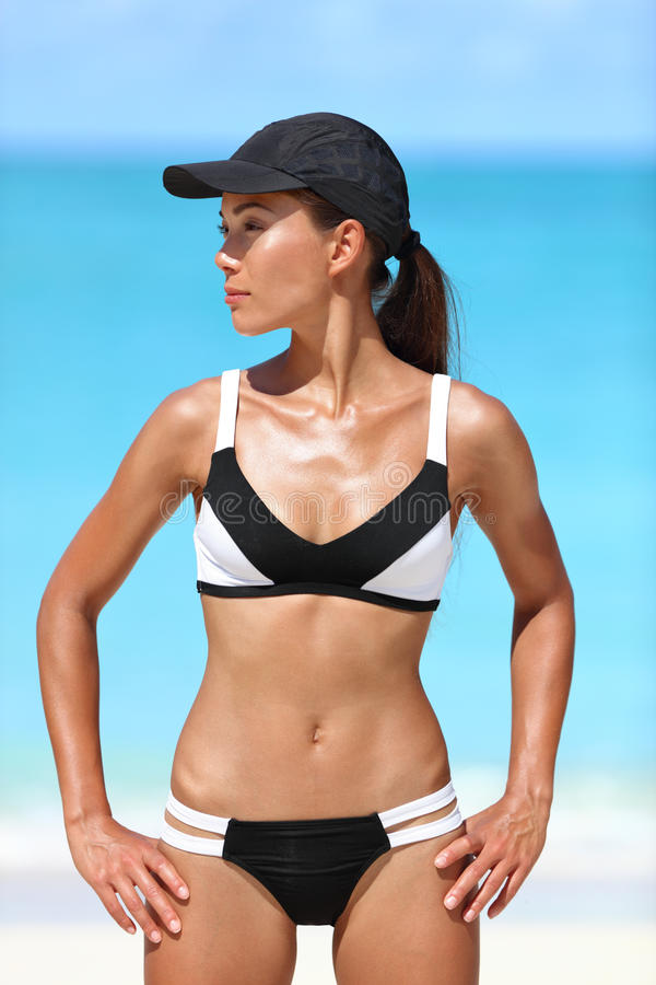 Sporty bikini fitness tanned body woman on beach royalty free stock image