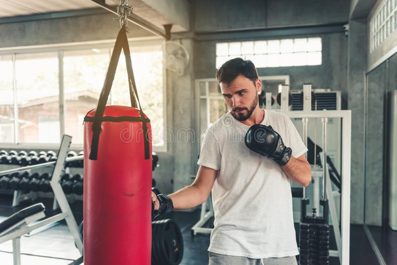 Sporty Boxer is Exercise Punching in Fitness Gym.,Portrait of Boxing Man is Practicing Footwork in Sportswear and Boxing Gloves., royalty free stock photos
