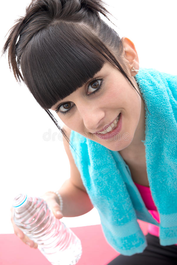 Sporty brunette woman with a bottle of water stock image