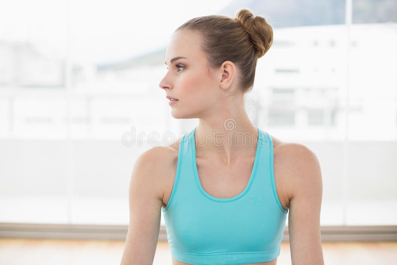 Sporty calm woman looking away royalty free stock image