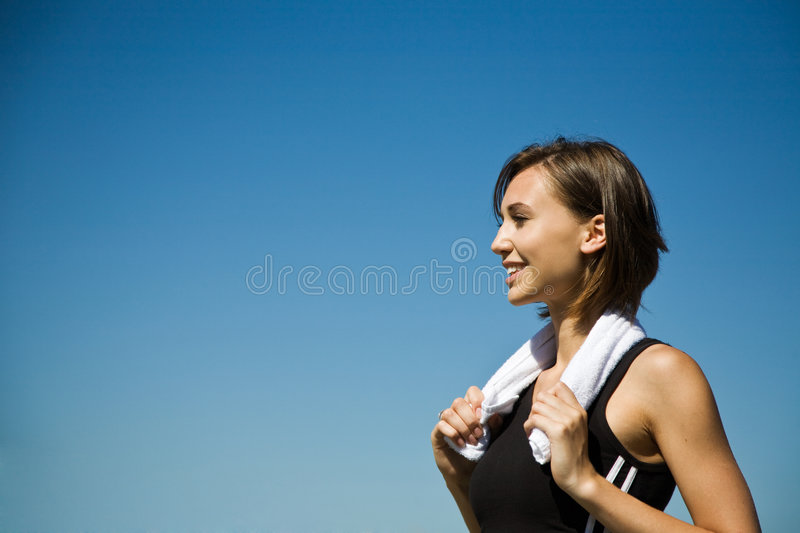 Sporty caucasian girl exercise. A beautiful sporty caucasian girl exercise outdoor stock photography