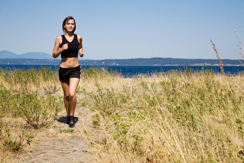 Sporty caucasian girl running stock photo