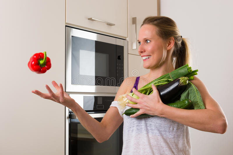 Sporty, Caucasian woman juggling vegetables for healthy nutrition stock photos
