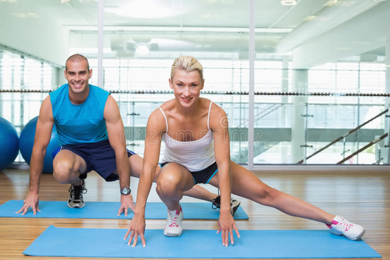 Sporty couple doing pilate exercises at fitness studio stock photo