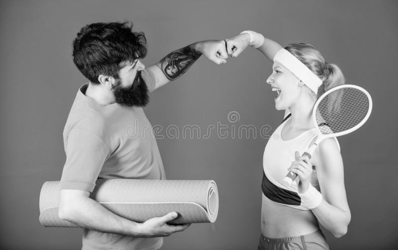 Sporty couple. Healthy lifestyle concept. Man and woman couple in love with yoga mat and sport equipment. Fitness stock image