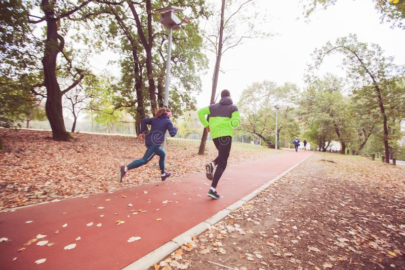 Sporty Couple Running On Fitness Trail In Forest stock images
