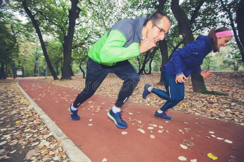 Sporty Couple Start Running On Fitness Trail In Forest royalty free stock photos