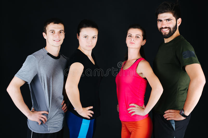 Sporty couples. Sporty young couples posing , close-up stock image