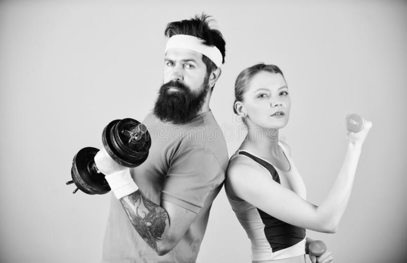 Sporty family. Healthy lifestyle concept. Man and woman exercising with dumbbells. Fitness exercises with dumbbells stock image