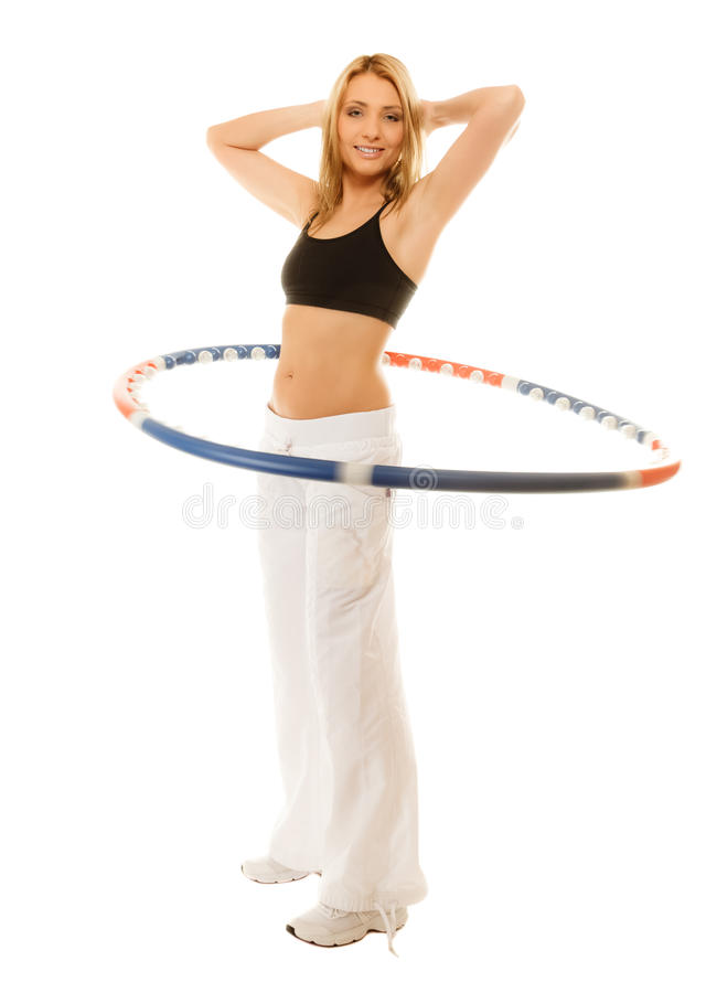 Sporty fit girl doing exercise with hula hoop. Sport training gym and lifestyle concept. Full length sporty girl doing exercise with hula hoop. Fitness woman stock photo