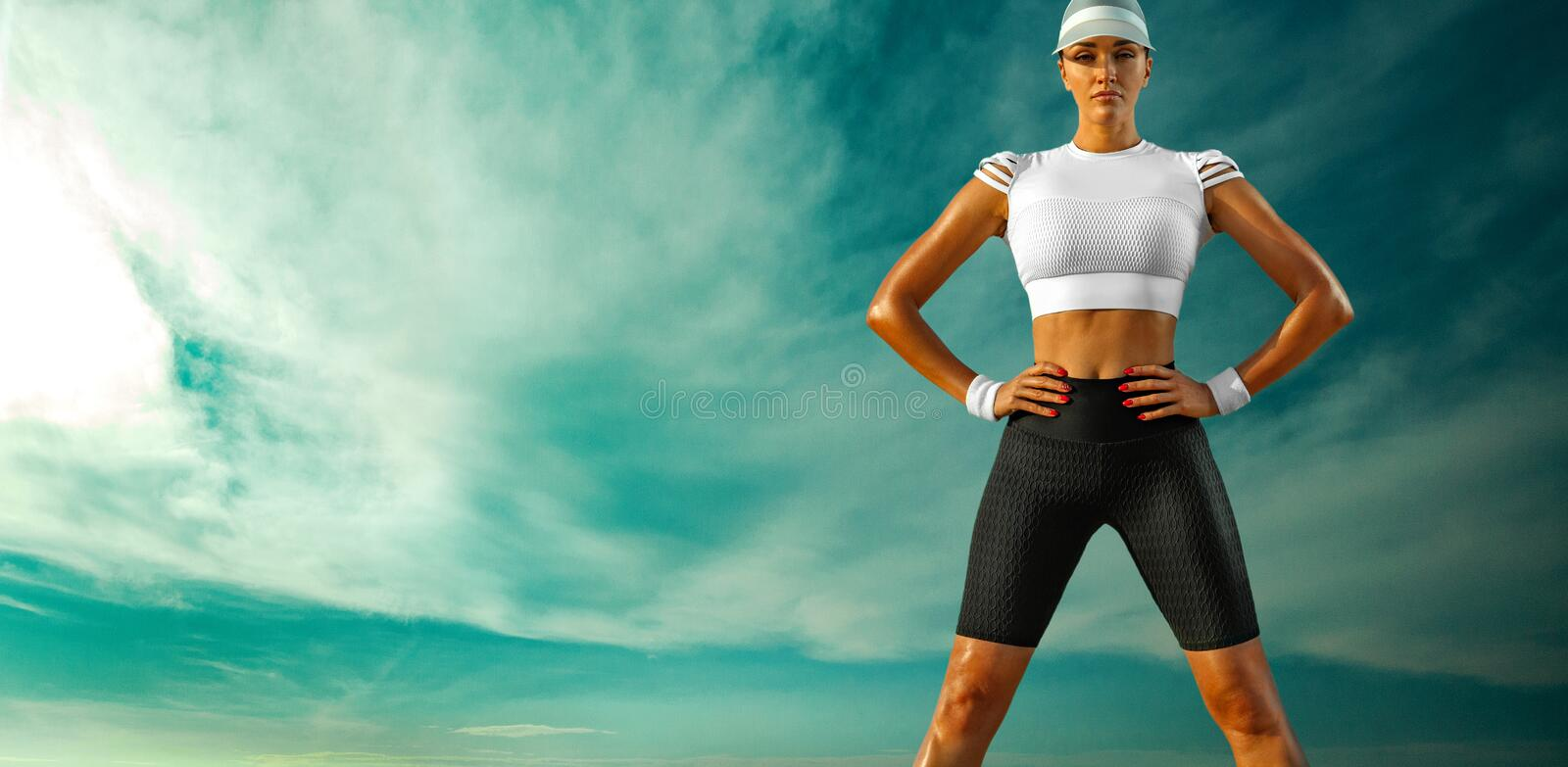 Sporty and fit young woman athlete relaxed after yoga training on the sky background. The concept of a healthy lifestyle royalty free stock images