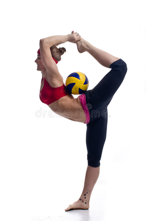 Sporty girl. Sporty smiling girl with ball isolated on white stock photography