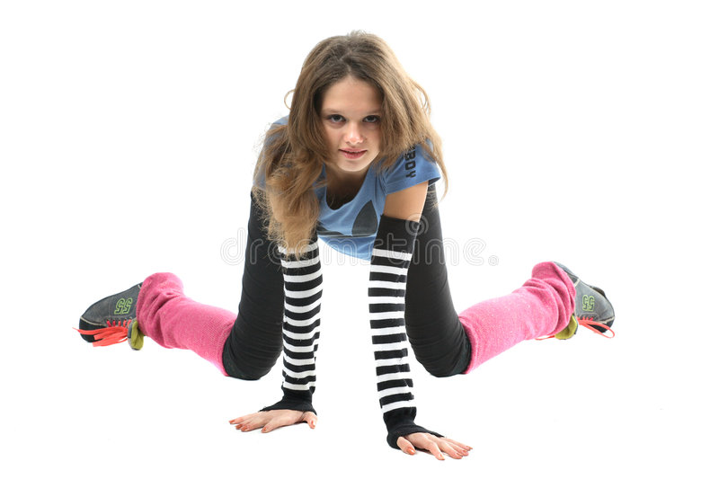 Sporty girl. Sporty teen in sports clothing, posed on hands and knees royalty free stock photo