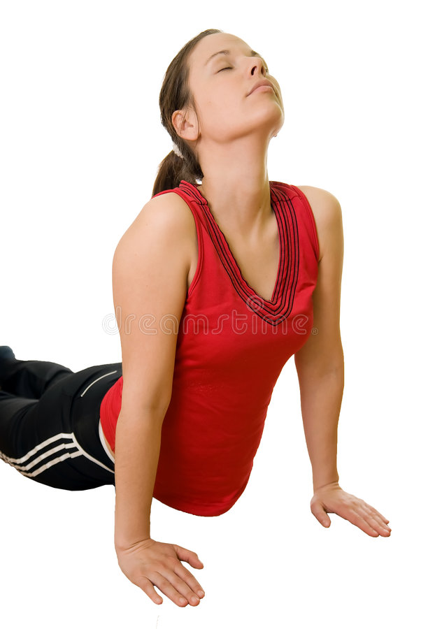 Sporty girl. Young girl in red shirt exercising - isolated with white background stock image