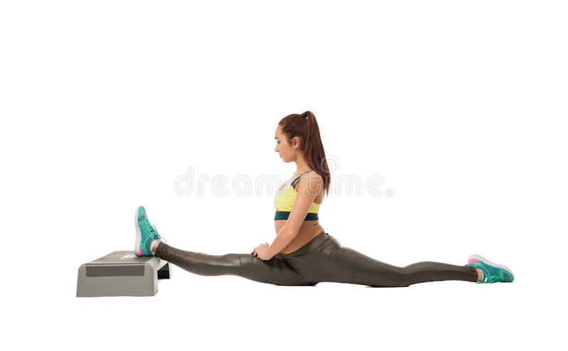 Sporty girl doing difficult stretching exercise royalty free stock photo
