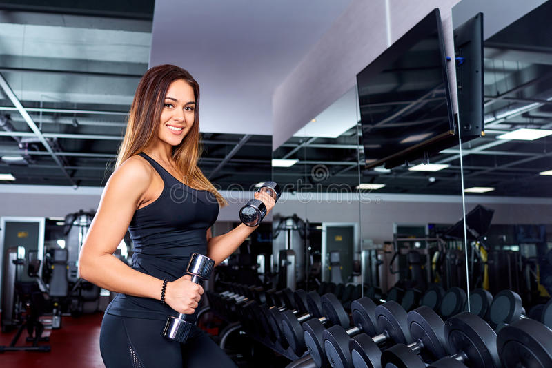 Sporty girl with dumbbells in the gym.Sport. stock photos