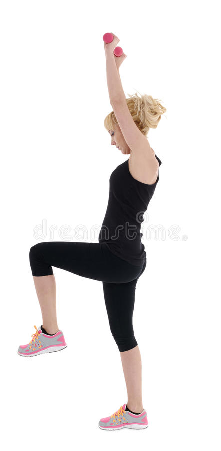 Sporty girl holding weights. Fitness gym concept. Healthy caucasian woman with dumbbells working out on white background. Fitness gym concept royalty free stock images