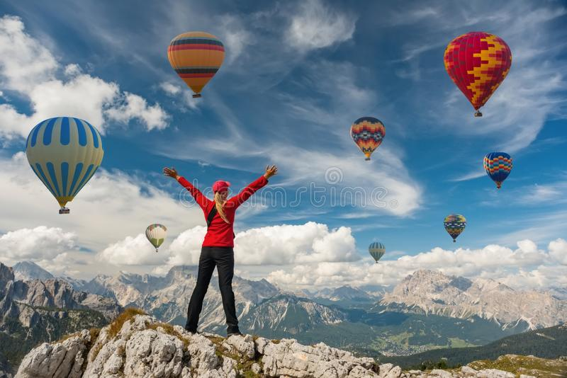 Sporty girl and hot air balloons. Freedom, achievement, achievement, happiness. Sporty girl and a lot of hot air balloons. The feeling of complete freedom stock photography