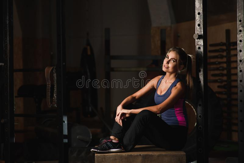 Sporty girl posing in a sports hall royalty free stock photo
