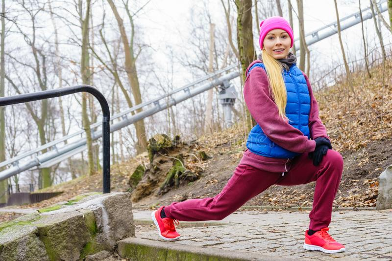 Sporty girl stretching outdoor in park royalty free stock photo