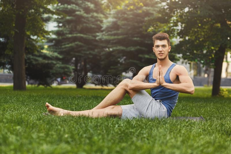 Young man practicing yogaoutdoors stock photos