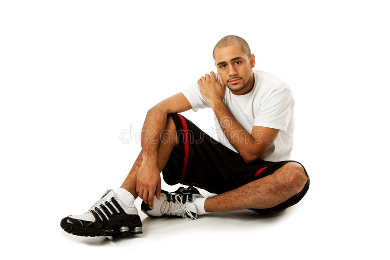 Sporty Guy Sitting Stock Images