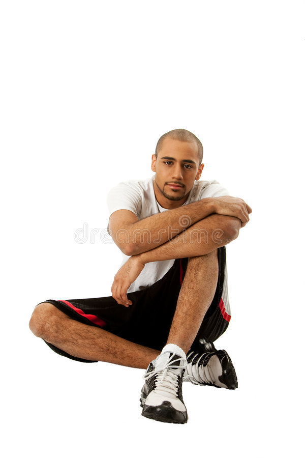 Sporty Guy Sitting Royalty Free Stock Photography