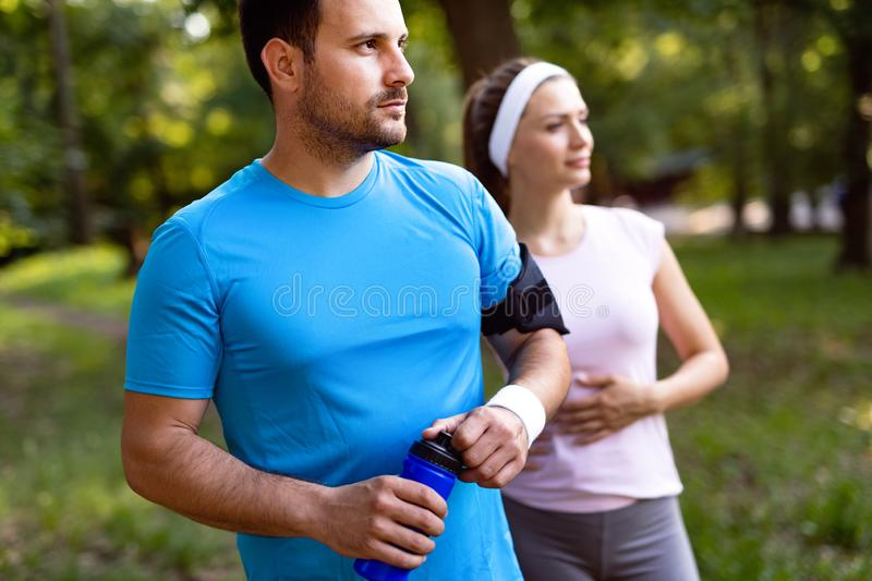 Sporty happy couple exercising together. Sport concept stock images