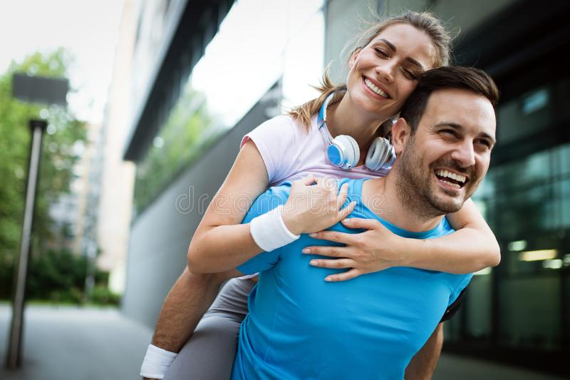 Sporty happy couple exercising together. Sport concept stock photo