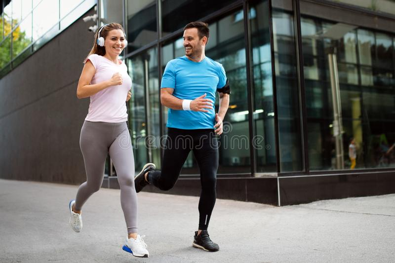 Sporty happy couple exercising together. Sport concept stock photography