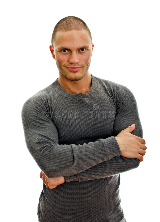Sporty male with arms folded.