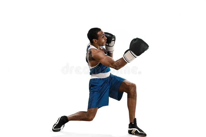 Sporty man during boxing exercise making hit. Photo of boxer on white background stock image