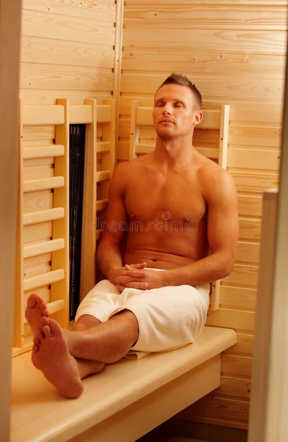 Sporty man enjoying sauna